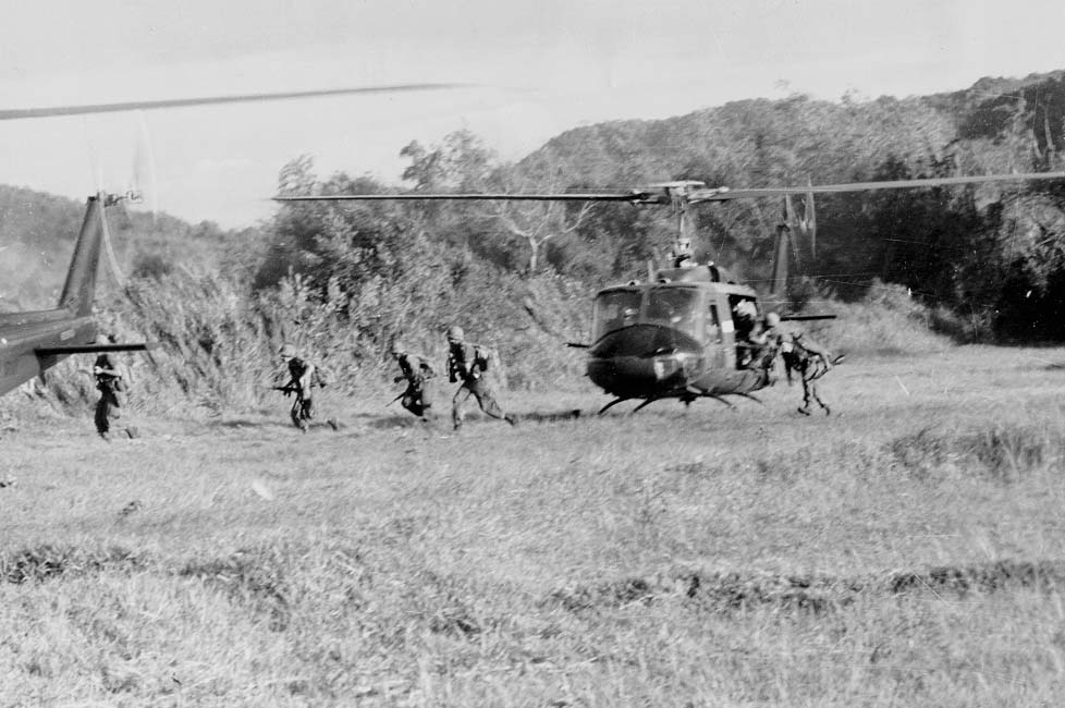 """1st Air Cavalry Division """"The First Team"""" Ia_Drang_Infantry_disembarking_from_Helicopter_LZ_X_ray"""